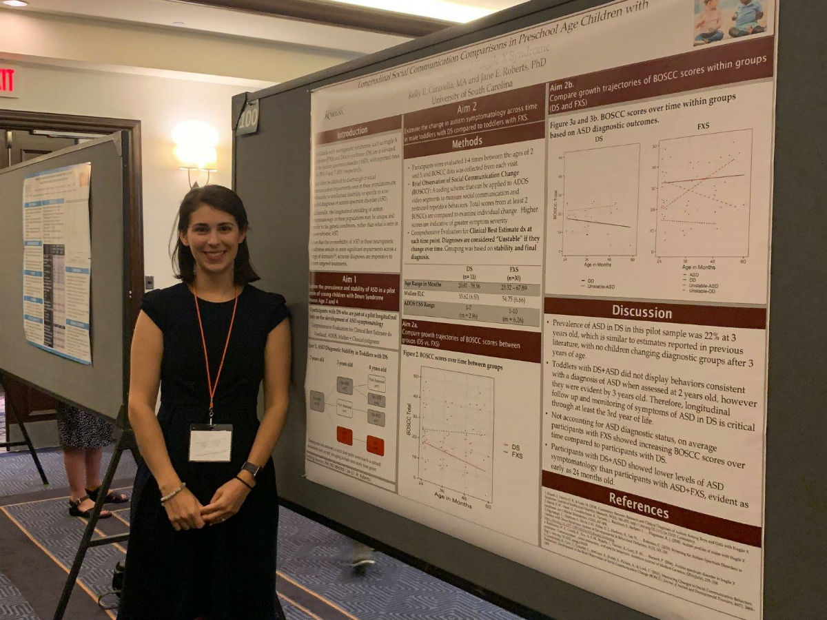 Kelly Caravella White presenting a poster at the 2019 Gatlinburg Conference