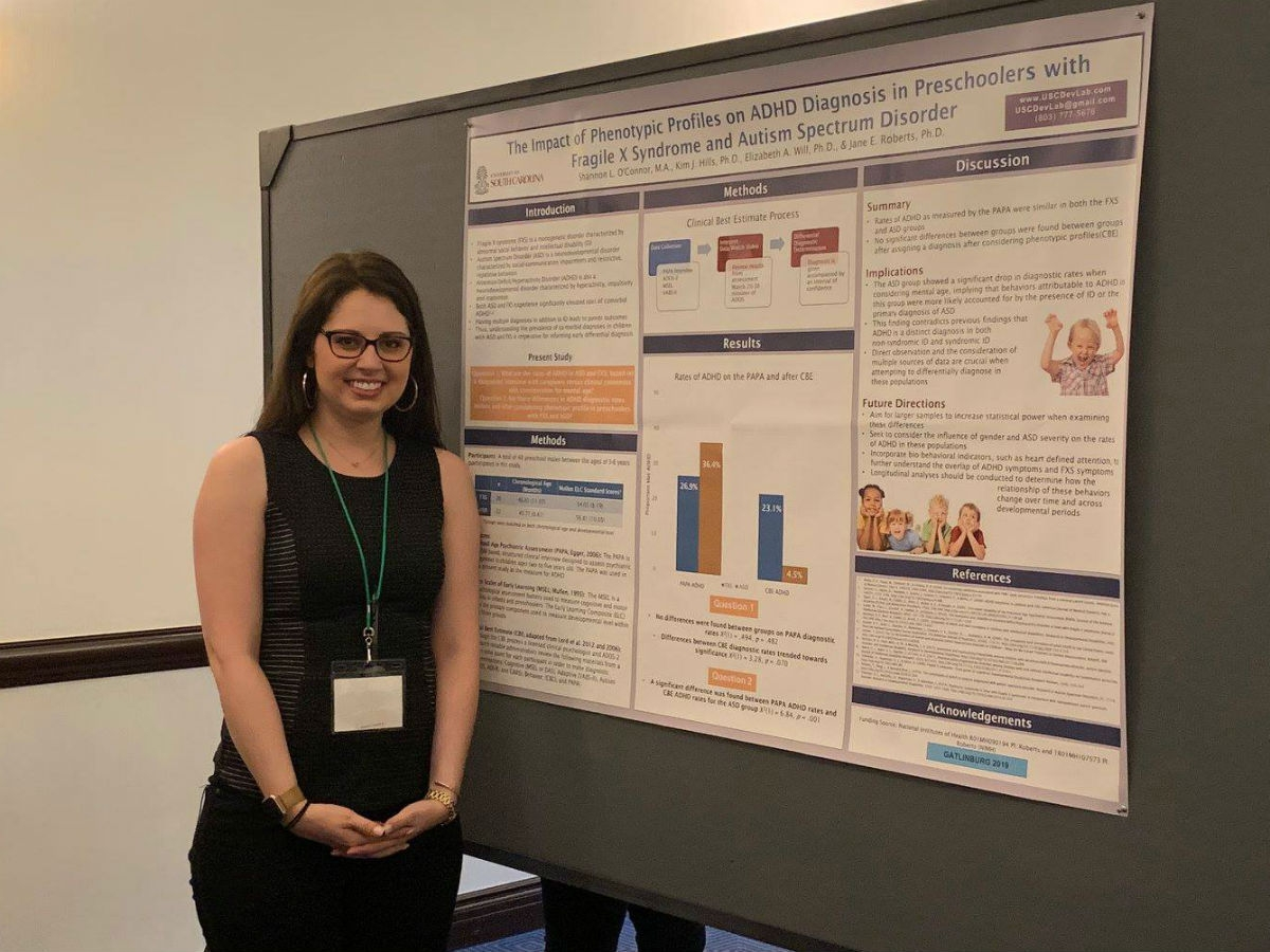 Shannon O'Connor presenting a poster at the 2019 Gatlinburg Conference