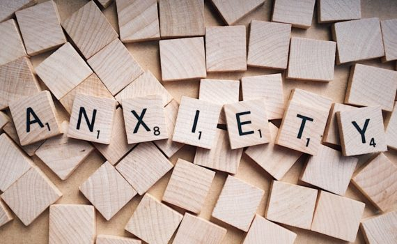 Scrabble tiles that spell out Anxiety