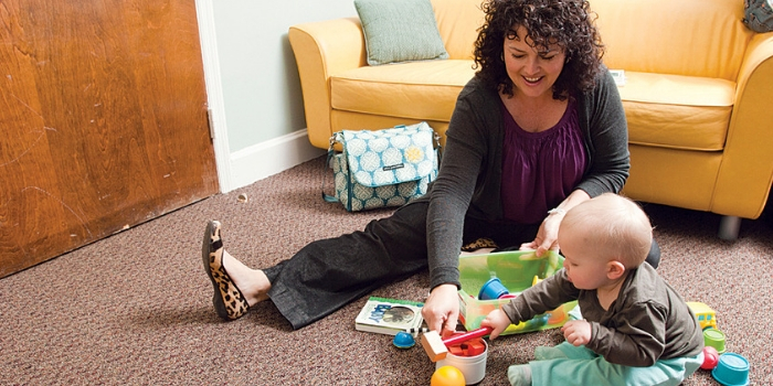 Dr. Roberts working with an infant in the study