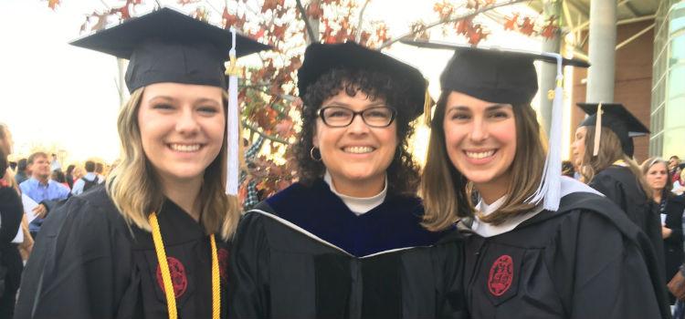 Kelly Caravella & Carly Moser at graduation with Dr. Roberts