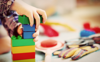 child playing with colorful toys